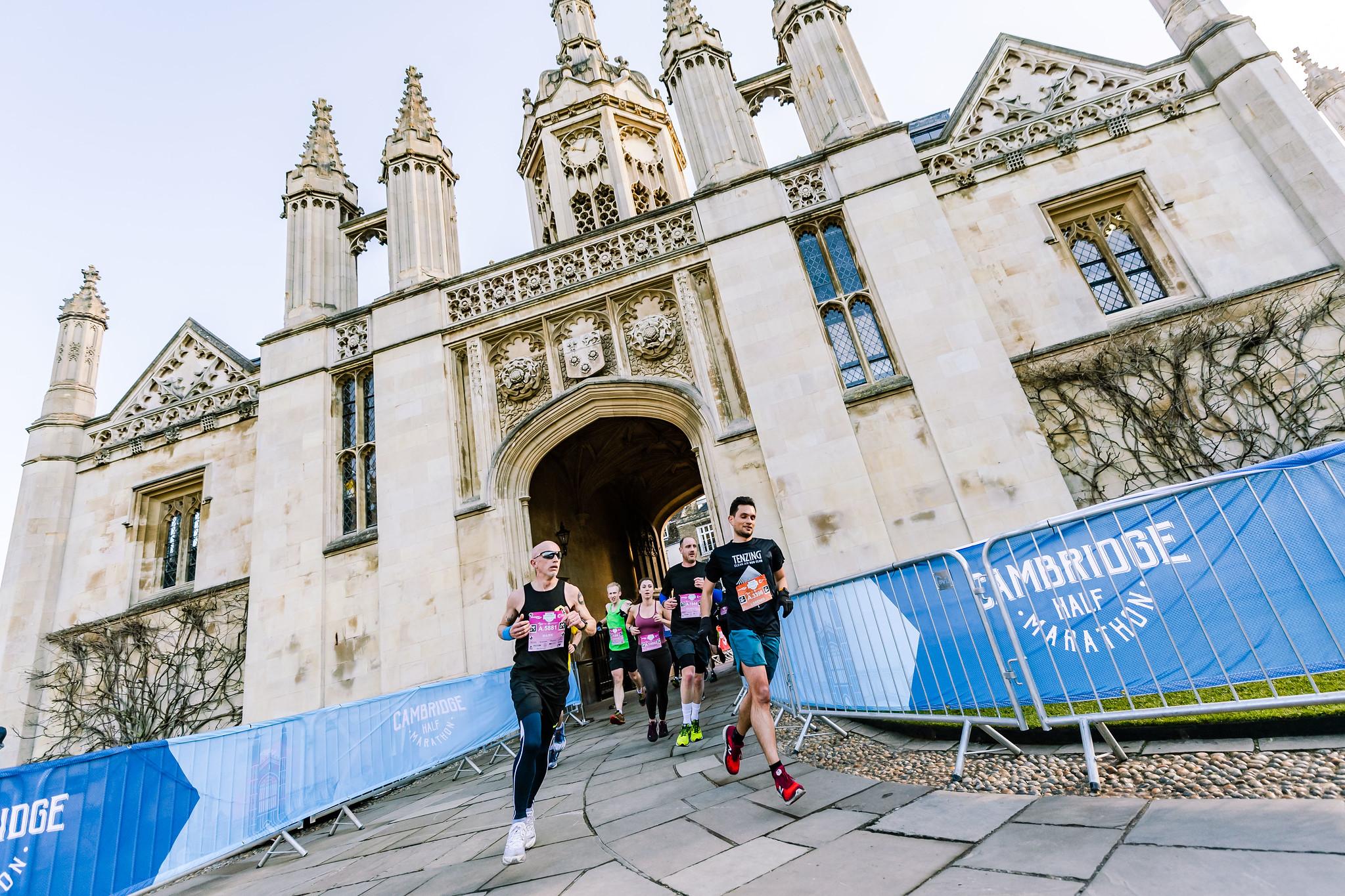 Runners run under Cambridge landmark